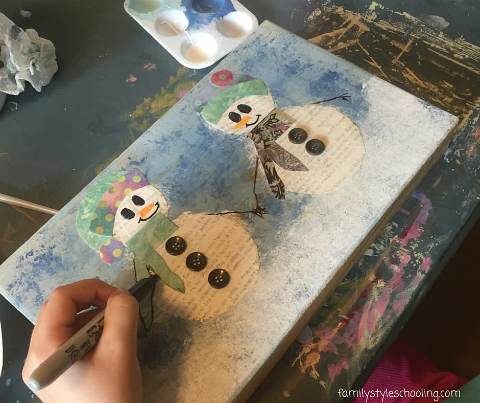 My youngest forgot to paint one side of her wooden block, so we just turned it sideways (happy accident) and she added two snowmen! I love it!